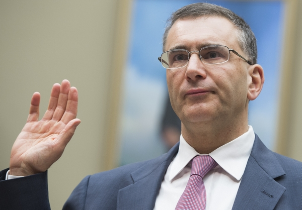 "Jonathan Gruber, an economics professor at Massachusetts Institute of Technology (MIT) and a consultant on the drafting of the Affordable Care Act legislation known as ""Obamacare,"" takes the oath prior to testifying during a US House Committee on Oversight and Government Reform hearing on Capitol Hill in Washington, DC, December 9, 2014. AFP PHOTO / SAUL LOEB        (Photo credit should read SAUL LOEB/AFP/Getty Images)"