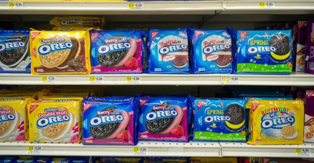 Boxes of Mondelez International's Oreo Cookies in multiple yummy flavors on a supermarket shelf in New York on Tuesday, March 9, 2015. Pershing Square Capital Management has invested $5.5 billion in the company, 7.5 percent stake. Mondelez International owns the Oreo, Cadbury and Trident brands. (© Richard B. Levine)