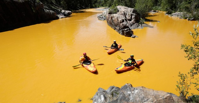 August 6, 2015 - Durango, Colorado: Kayakers Dan Steaves, Eric Parker and David Farkas find themselves surrounded Thursday, August 6th 2015, north of Durango Colo., by the toxic mine waste that began flowing Wednesday into the Animas River from the Gold King Mine north of Silverton. (Jerry McBride/Durango Herald/Polaris) (Newscom TagID: polspphotos160865.jpg) [Photo via Newscom]