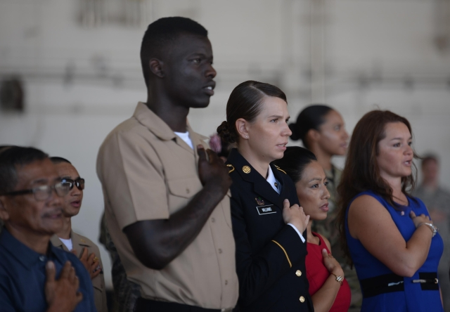 Service members, spouses, families receive U.S. citizenship on Andersen